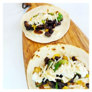 Tacos with Brussel Sprouts on a natural wood cutting board